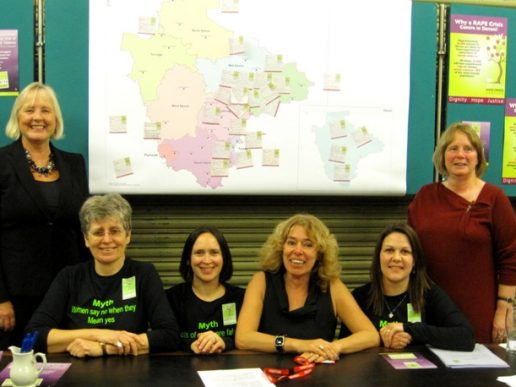 DRCSAS Launch 2011 - 6 smiling women in front of a map of Devon