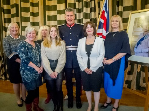 staff and volunteers receiving the Queens Award from the Lord Lieutenant at County Hall Exeter Devon