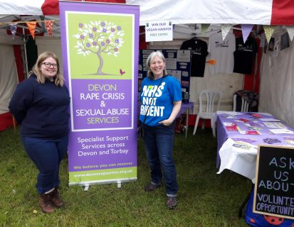 DRCSAS staff next to DRCSAS banner at Exeter Respect Festival