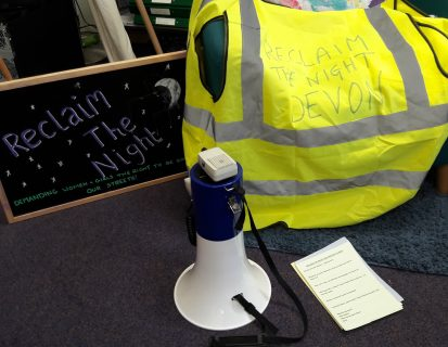 High Vis jacket, Megaphone and Reclaim the Night sign