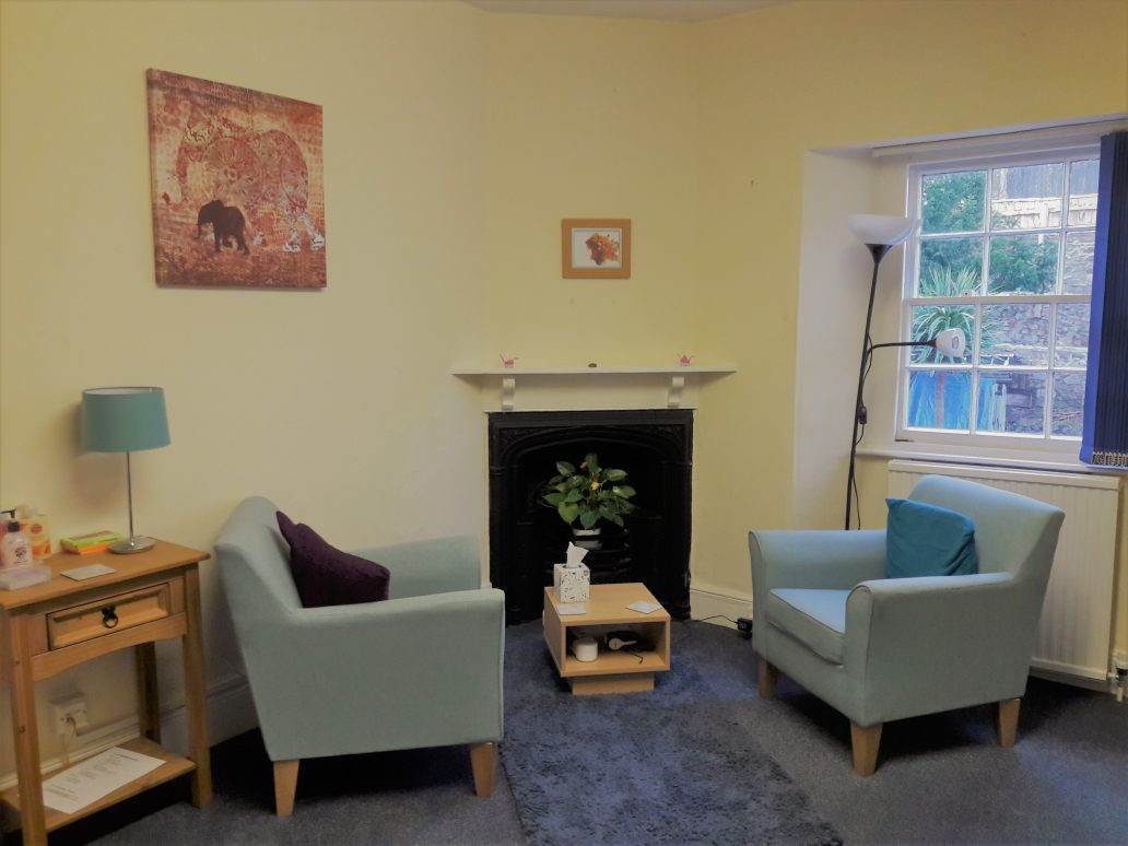 Torbay Support Room - Light room with comfy chairs, artwork and coffee table