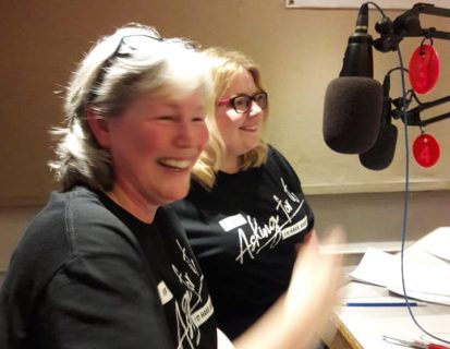 Two DRCSAS staff in a radio studio wearing Tshirt which says 'if I was asking for it I'd have asked for it'