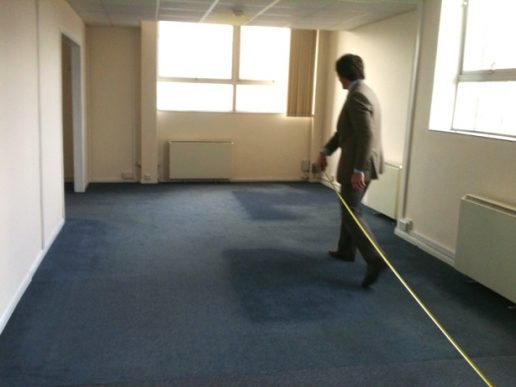 2011 - Empty office being measured by one person